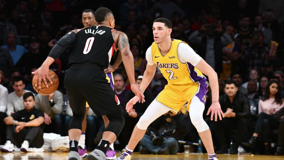 Lonzo Ball #2 of the Los Angeles Lakers defends against Damian Lillard #0 of the Portland Trail Blazers during the fourth quarter of a basketball game between the two teams at Staples Center on March 5, 2018 in Los Angeles, California.