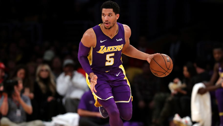 LOS ANGELES, CA - DECEMBER 23:  Josh Hart #5 of the Los Angeles Lakers dribbles the ball upcourt during the first half of a game against the Portland Trail Blazers at Staples Center on December 23, 2017 in Los Angeles, California. NOTE TO USER: User expressly acknowledges and agrees that, by downloading and or using this photograph, User is consenting to the terms and conditions of the Getty Images License Agreement.  (Photo by Sean M. Haffey/Getty Images)