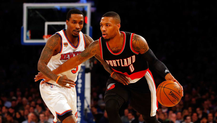 NEW YORK, NY - NOVEMBER 22:  (NEW YORK DAILIES OUT)    Damian Lillard #0 of the Portland Trail Blazers in action against Brandon Jennings #3 of the New York Knicks at Madison Square Garden on November 22, 2016 in New York City. The Knicks defeated the Trail Blazers 107-103.  NOTE TO USER: User expressly acknowledges and agrees that, by downloading and/or using this Photograph, user is consenting to the terms and conditions of the Getty Images License Agreement.  (Photo by Jim McIsaac/Getty Images)