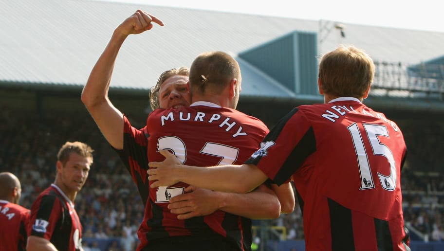 PORTSMOUTH, UNITED KINGDOM - MAY 11:  Danny Murphy of Fulham is congratulated by teammates, Jimmy Bullard (L) and Erik Nevland after scoring the opening goal during the Barclays Premier League match between Portsmouth and Fulham at Fratton Park on  May 11, 2008 in Portsmouth, England.  (Photo by Hamish Blair/Getty Images)