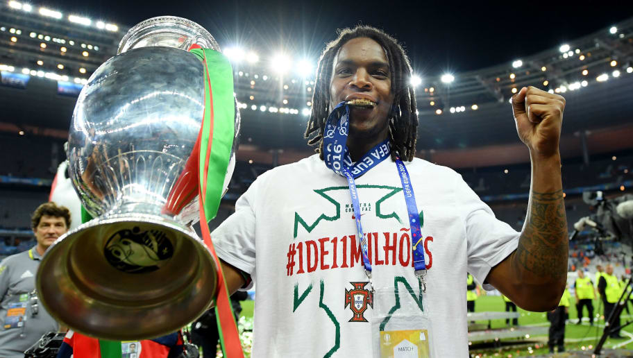 PARIS, FRANCE - JULY 10: Renato Sanches of Portugal holds the Henri Delaunay trophy to celebrate after his team's 1-0 win against France in the UEFA EURO 2016 Final match between Portugal and France at Stade de France on July 10, 2016 in Paris, France. (Photo by Matthias Hangst/Getty Images)