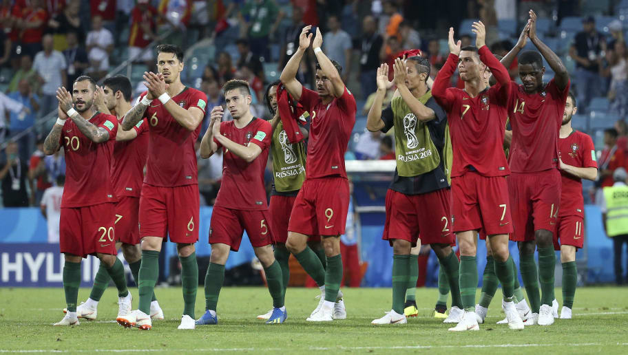 SOCHI, RUSSIA - JUNE 15: Captain Cristiano Ronaldo of Portugal celebrates with teammates following the 2018 FIFA World Cup Russia group B match between Portugal and Spain at Fisht Stadium on June 15, 2018 in Sochi, Russia. (Photo by Jean Catuffe/Getty Images)