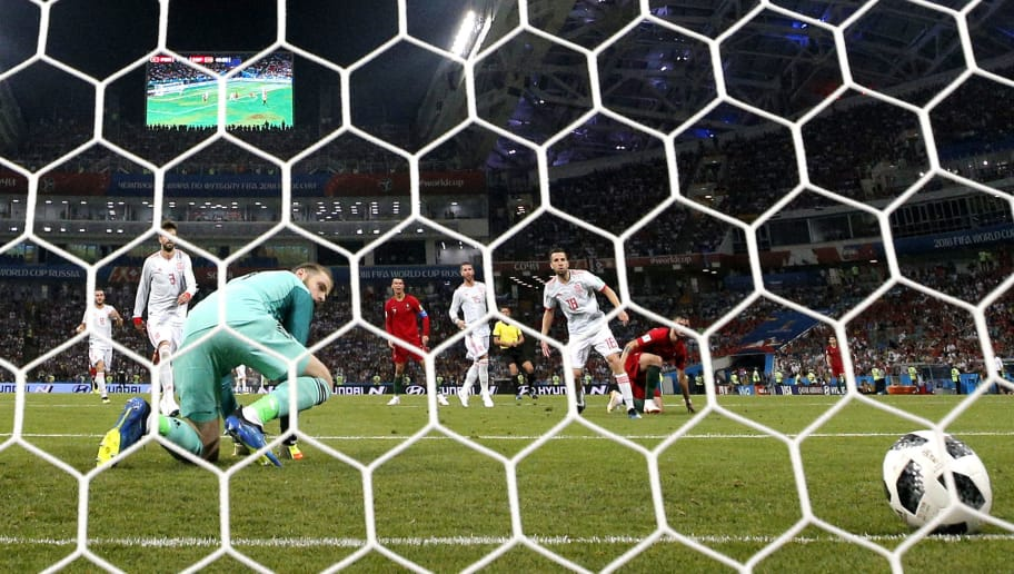 SOCHI, RUSSIA - JUNE 15: David De Gea of Spain is down on his knees as he makes a mistake as Cristiano Ronaldo of Portugal scores his sides second goal during the 2018 FIFA World Cup Russia group B match between Portugal and Spain at Fisht Stadium on June 15, 2018 in Sochi, Russia.  (Photo by Dean Mouhtaropoulos/Getty Images)