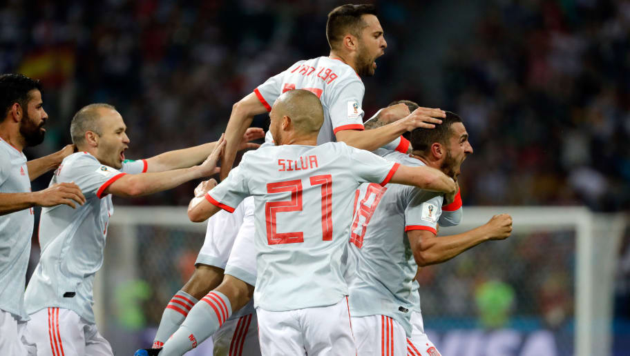 SOCHI, RUSSIA - JUNE 15: Nacho Fernandez of Spain celebrates after scoring his team's third goal with team mates during the 2018 FIFA World Cup Russia group B match between Portugal and Spain at Fisht Stadium on June 15, 2018 in Sochi, Russia. (Photo by TF-Images/Getty Images)