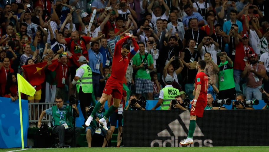 SOCHI, RUSSIA - JUNE 15: Cristiano Ronaldo of Portugal celebrates after scoring his team's first goal during the 2018 FIFA World Cup Russia group B match between Portugal and Spain at Fisht Stadium on June 15, 2018 in Sochi, Russia. (Photo by TF-Images/Getty Images)