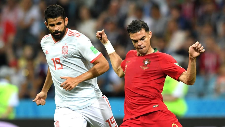 SOCHI, RUSSIA - JUNE 15:  Pepe of Portugal is challenged by Diego Costa of Spain during the 2018 FIFA World Cup Russia group B match between Portugal and Spain at Fisht Stadium on June 15, 2018 in Sochi, Russia.  (Photo by Stu Forster/Getty Images)
