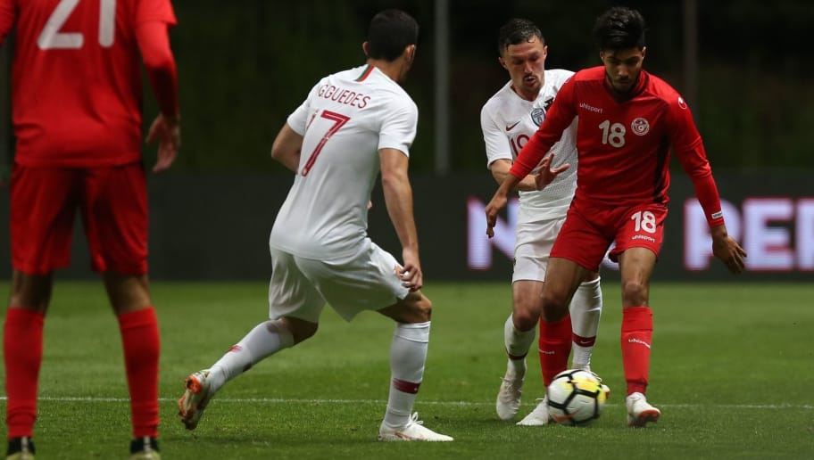 BRAGA, PORTUGAL - MAY 28:  Tunisia forward Bassem Srarfi with Portugal and SSC Napoli defender Mario Rui in action during the International Friendly match between Portugal and Tunisia at Estadio Municipal de Braga on May 28, 2018 in Braga, Portugal.  (Photo by Gualter Fatia/Getty Images)
