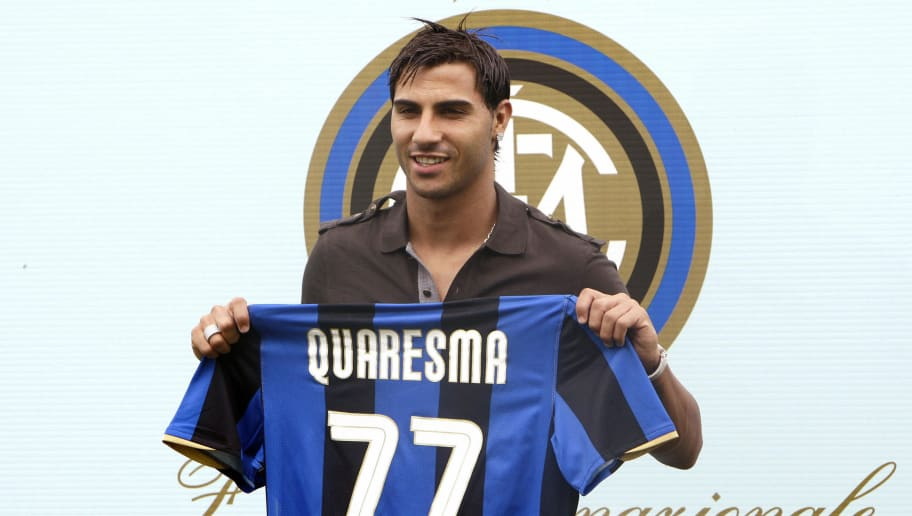 Portugal winger Ricardo Quaresma poses with his new jersey after signing for Inter Milan in Appiano Gentile, north-west of Milan, on September 2, 2008.  The 25-year-old was one of Inter boss Jose Mourinho's top transfer targets and the former Chelsea manager got his man with only hours remaining to the end of the September 1 deadline. AFP PHOTO / GIUSEPPE CACACE (Photo credit should read GIUSEPPE CACACE/AFP/Getty Images)