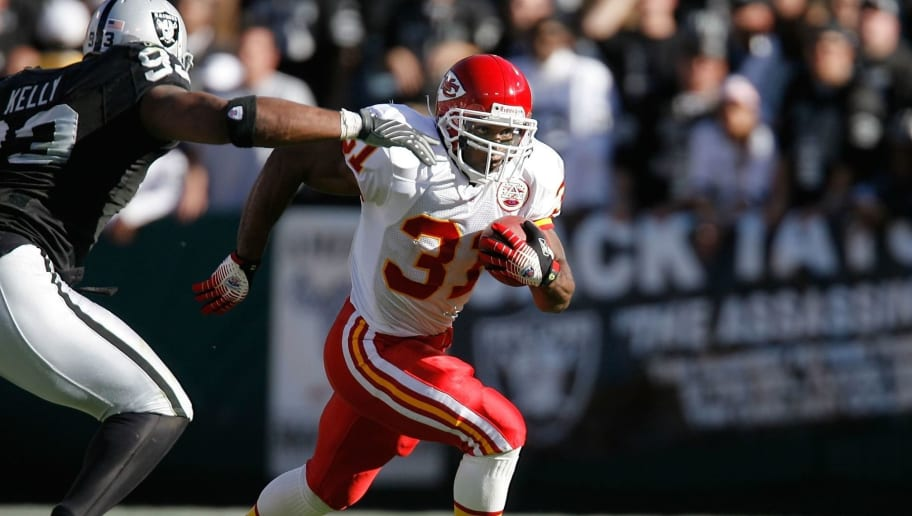 OAKLAND - OCTOBER 21:  Running back Priest Holmes #31 of the Kansas City Chiefs gains eight yards during a game against the Oakland Raiders at McAfee Coliseum October 21, 2007 in Oakland, California.  (Photo by Greg Trott/Getty Images)