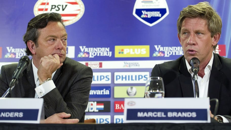 PSV Eindhoven managing director Tiny Sanders (L) and and technical manager Marcel Brands speak during a press conference in Eindhoven, on March 12, 2012 announcing that PSV Eindhoven coach Fred Rutten's contract was terminated . Rutten has been sacked following three straight defeats, the Dutch first division club announced Monday and will be replaced by his assistant Phillip Cocu until the end of the season. AFP PHOTO / ANP MARCEL VAN HOORN netherlands out (Photo credit should read MARCEL VAN HOORN/AFP/Getty Images)
