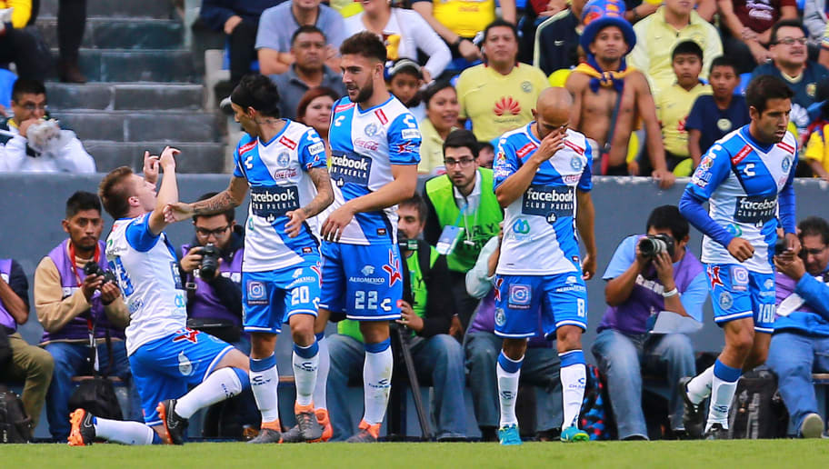 PUEBLA, MEXICO - APRIL 20: Alejandro Chumacero of Puebla celebrates with teammates after scoring the first goal of his team during the 16th round match between Puebla and America as part of the Torneo Clausura 2018 Liga MX at Cuauhtemoc Stadium on April 20, 2018 in Puebla, Mexico. (Photo by Manuel Velasquez/Getty Images)