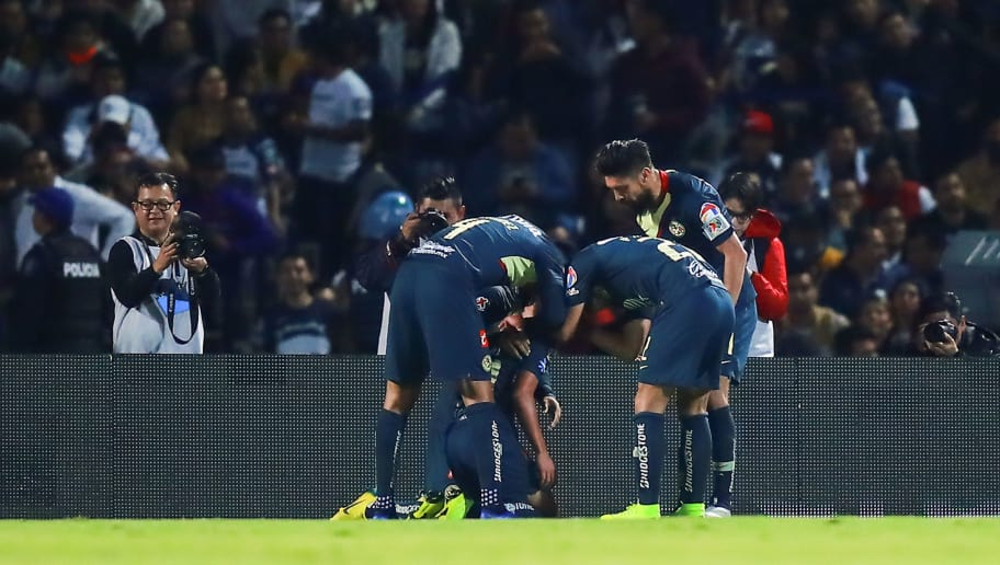 MEXICO CITY, MEXICO - DECEMBER 06: Diego Lainez #20 of America celebrates with teammates after scoring the first goal of his team during the semifinal first leg match between Pumas UNAM and America as part of the Torneo Apertura 2018 Liga MX at Olimpico Universitario Stadium on December 6, 2018 in Mexico City, Mexico. (Photo by Hector Vivas/Getty Images)