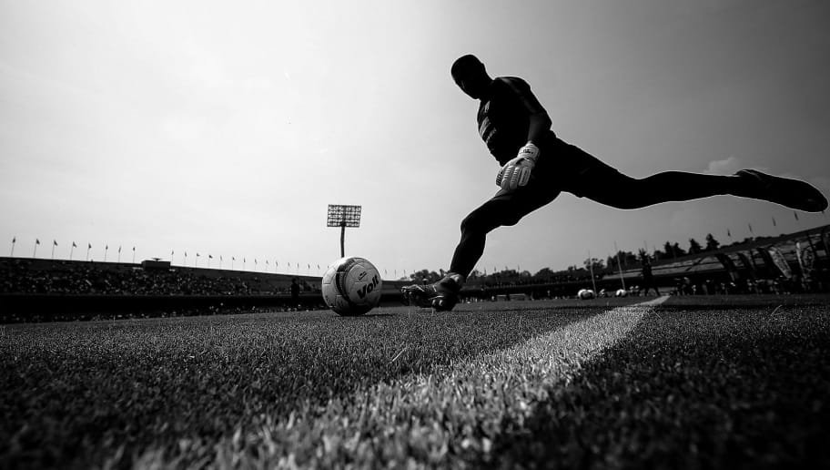 MEXICO CITY, MEXICO - APRIL 29: (Editor´s Note: Image has been converted into black and white) Bernabe Magana of Pumas kicks the ball during the 17th round match between Pumas UNAM and Queretaro as part of the Torneo Clausura 2018 Liga MX at Olimpico Universitario Stadium on April 1, 2018 in Mexico City, Mexico.  (Photo by Hector Vivas/Getty Images)