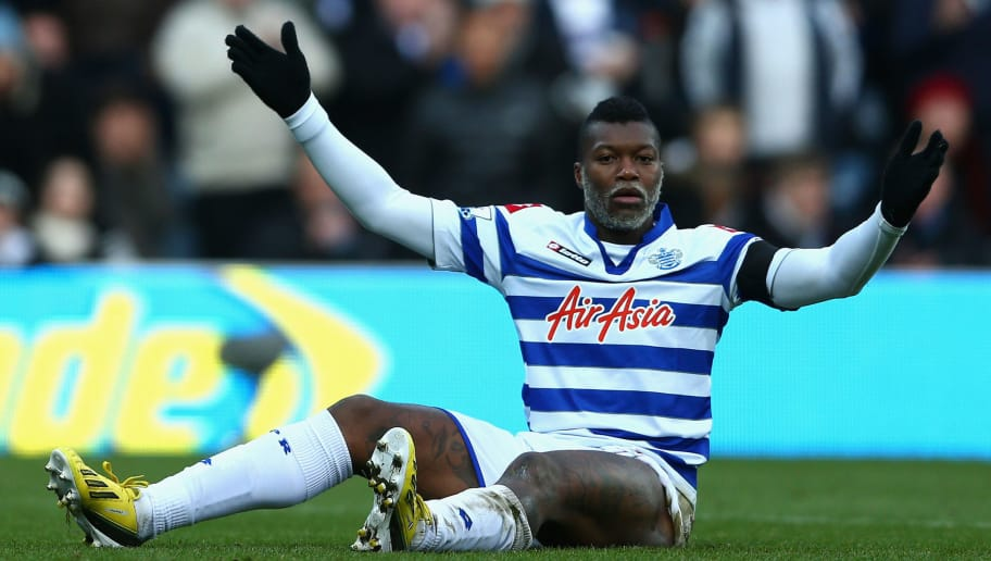 LONDON, ENGLAND - DECEMBER 15:  Djibril Cisse of Queens Park Rangers looks dejected during the Barclays Premier League match between Queens Park Rangers and Fulham at Loftus Road on December 15, 2012 in London, England.  (Photo by Paul Gilham/Getty Images)