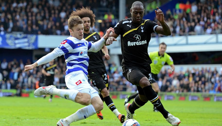 LONDON, ENGLAND - APRIL 21:  Jamie Mackie of QPR and Ledley King of Spurs compete for the ball during the Barclays Premier League match between Queens Park Rangers and Tottenham Hotspur at Loftus Road on April 21, 2012 in London, England.  (Photo by Shaun Botterill/Getty Images)