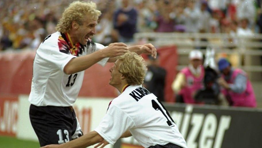 R. Voller and Jurgen Klinsman of Germany