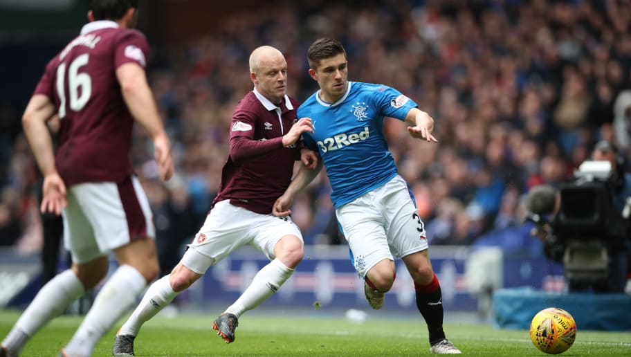 GLASGOW, SCOTLAND - APRIL 22: Steven Naismith of Heart of Midlothian vies with Declan John of Rangers during the Ladbrokes Scottish Premiership match between Rangers and Hearts at Ibrox Stadium on April 22, 2018 in Glasgow, Scotland. (Photo by Ian MacNicol/Getty Images)
