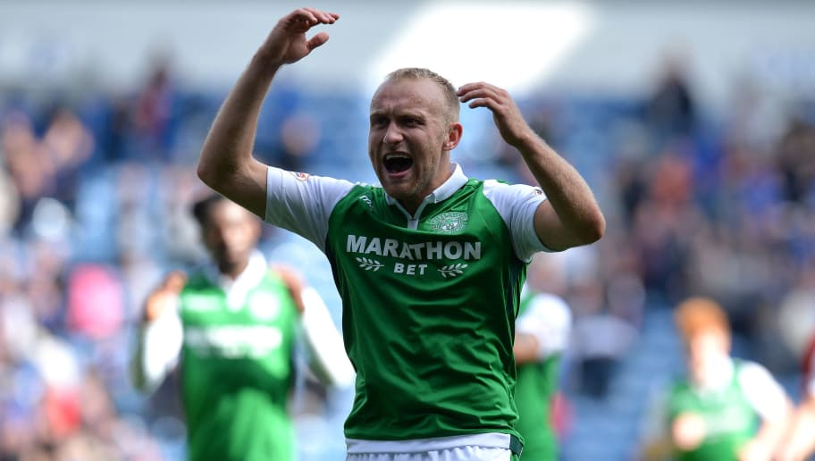 GLASGOW, SCOTLAND - AUGUST 12: Dylan McGeouch of Hibernian gestures to the Hibs fans at the final whistle during the Ladbrokes Scottish Premiership match between Rangers and Hibernian at Ibrox Stadium on August 12, 2017 in Glasgow, Scotland. (Photo by Mark Runnacles/Getty Images)