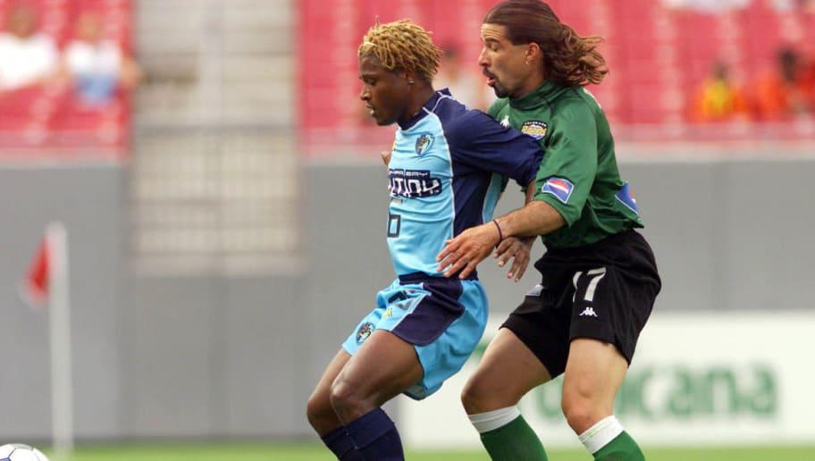 21 Jul 2001: Jair #26 of the Tampa Bay Mutiny and Marcelo Balboa #17 of the Colorado Rapids fight for possession of the ball at Raymond James Stadium in Tampa, Florida. The Rapids won 2-1 over the Mutiny. DIGITAL IMAGE. Mandatory Credit: Andy Lyons/ALLSPORT