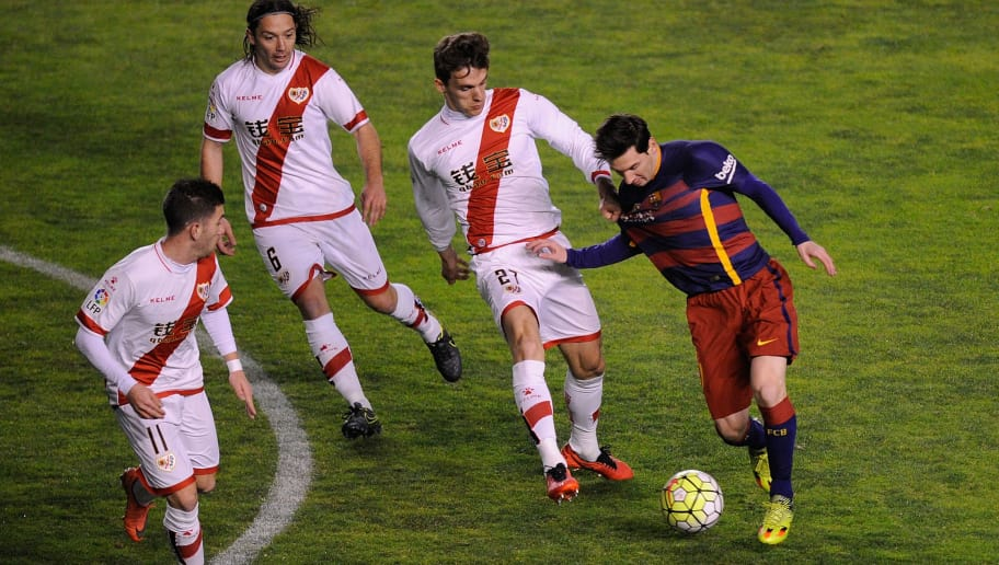 MADRID, SPAIN - MARCH 03:  Lionel Messi of FC Barcelona takes on Diego Javier Llorente (#27) Manuel Rolando Iturra and  Adrian Embarba of Rayo Vallecano during the La Liga match between Rayo Vallecano and FC Barcelona at Estadio de Vallecas on March 3, 2016 in Madrid, Spain.  (Photo by Denis Doyle/Getty Images)