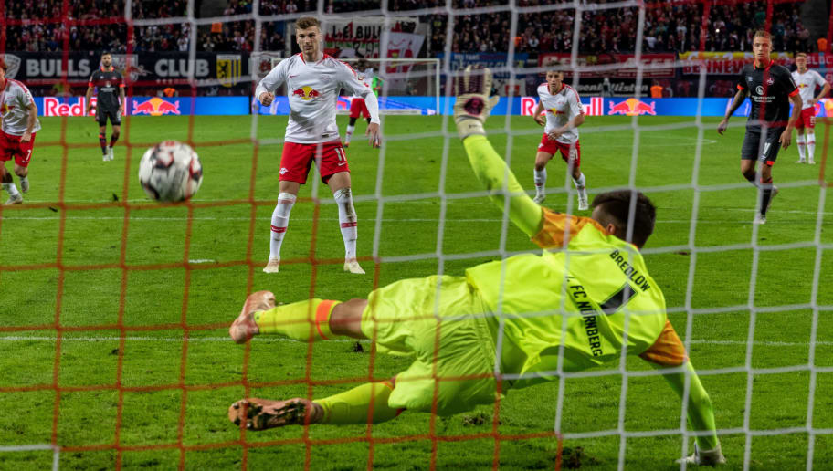 LEIPZIG, GERMANY - OCTOBER 07:  Goalkeeper Fabian Bredlow of 1. FC Nuernberg saves a penalty shooten by Timo Werner of RB Leipzig during the Bundesliga match between RB Leipzig and 1. FC Nuernberg at Red Bull Arena on October 7, 2018 in Leipzig, Germany.  (Photo by Boris Streubel/Bongarts/Getty Images)