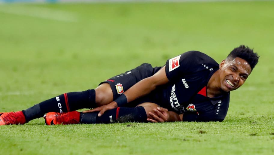 LEIPZIG, GERMANY - APRIL 09:  Wendell of Leverkusen lies injured on the pitch during the Bundesliga match between RB Leipzig and Bayer 04 Leverkusen at Red Bull Arena on April 9, 2018 in Leipzig, Germany.  (Photo by Martin Rose/Bongarts/Getty Images)