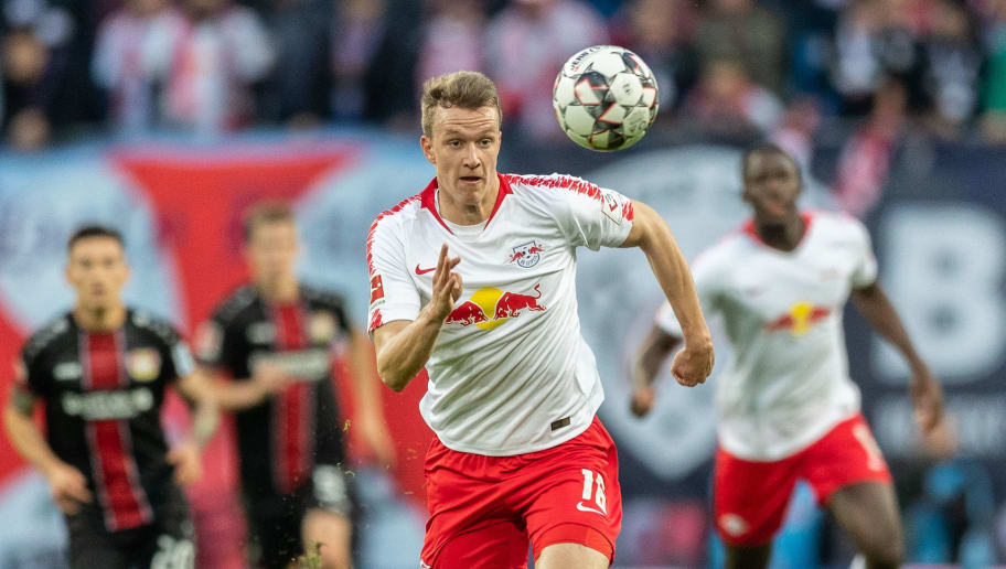 LEIPZIG, GERMANY - NOVEMBER 11:Lukas Klostermann of RB Leipzig runs with the ball during the Bundesliga match between RB Leipzig and Bayer 04 Leverkusen at Red Bull Arena on November 11, 2018 in Leipzig, Germany. (Photo by Boris Streubel/Getty Images)
