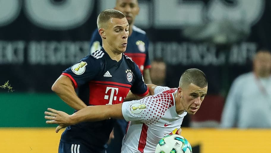 LEIPZIG, GERMANY - OCTOBER 25: Joshua Kimmich of Muenchen and Diego Demme of Leipzig battle for the ball during the DFB Cup round 2 match between RB Leipzig and Bayern Muenchen at Red Bull Arena on October 25, 2017 in Leipzig, Germany. (Photo by TF-Images/TF-Images via Getty Images)