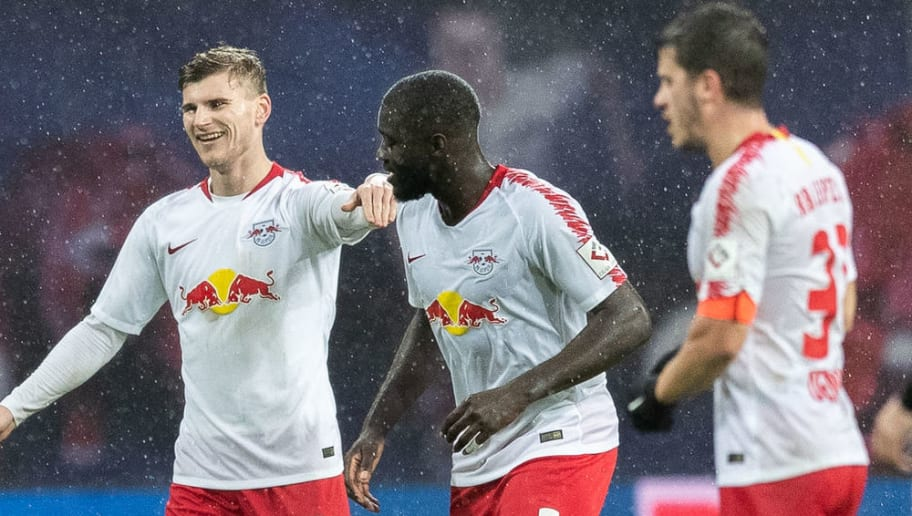 LEIPZIG, GERMANY - DECEMBER 02: Timo Werner of RB Leipzig celebrates with team mate Dayot Upamecano of RB Leipzig after scoring his team's second goal uring the Bundesliga match between RB Leipzig and Borussia Moenchengladbach at Red Bull Arena on December 2, 2018 in Leipzig, Germany. (Photo by Boris Streubel/Bongarts/Getty Images)