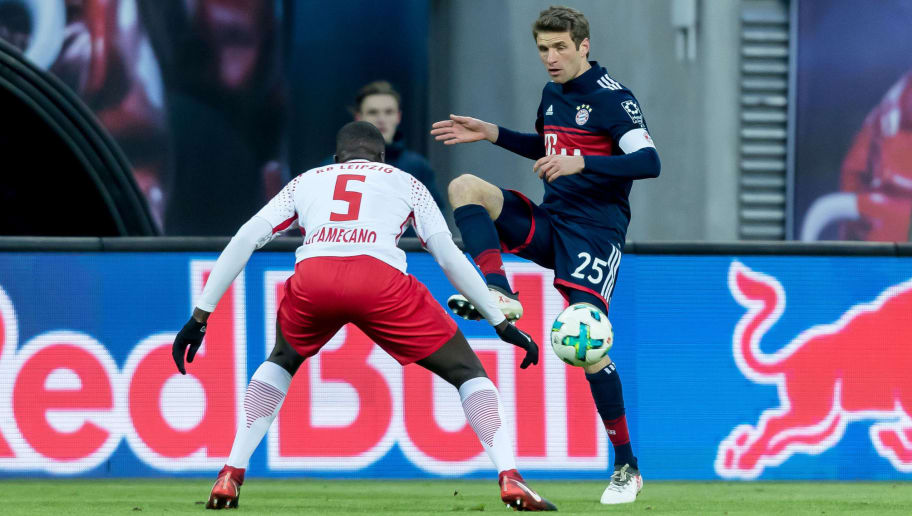 LEIPZIG, GERMANY - MARCH 18: Dayot Upamecano of Leipzig and Thomas Mueller of Muenchen battle for the ball during the Bundesliga match between RB Leipzig and FC Bayern Muenchen at Red Bull Arena on March 18, 2018 in Leipzig, Germany. (Photo by TF-Images/Getty Images)
