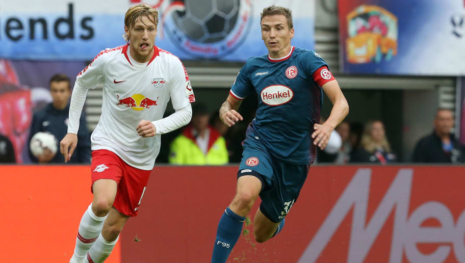 LEIPZIG, GERMANY - SEPTEMBER 02:  Emil Forsberg (L) of Leipzig battles for the ball with Marcel Sobottka of Duesseldorf during the Bundesliga match between RB Leipzig and Fortuna Duesseldorf at Red Bull Arena on September 2, 2018 in Leipzig, Germany.  (Photo by Matthias Kern/Bongarts/Getty Images)