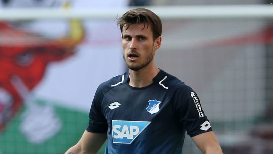 LEIPZIG, GERMANY - APRIL 21:  Havard Nordtveit of Hoffenheim runs with the ball during the Bundesliga match between RB Leipzig and TSG 1899 Hoffenheim at Red Bull Arena on April 21, 2018 in Leipzig, Germany. (Photo by Matthias Kern/Bongarts/Getty Images)