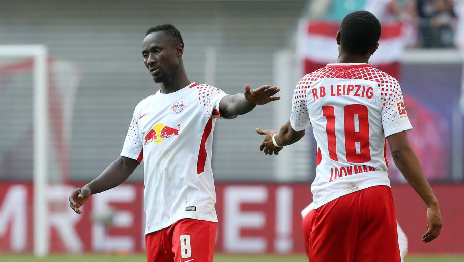 LEIPZIG, GERMANY - APRIL 21:  Naby Deco Keita (L) of Leipzig and team mate Ademola Lookman show their frustration after loosing the Bundesliga match between RB Leipzig and TSG 1899 Hoffenheim at Red Bull Arena on April 21, 2018 in Leipzig, Germany. (Photo by Matthias Kern/Bongarts/Getty Images)