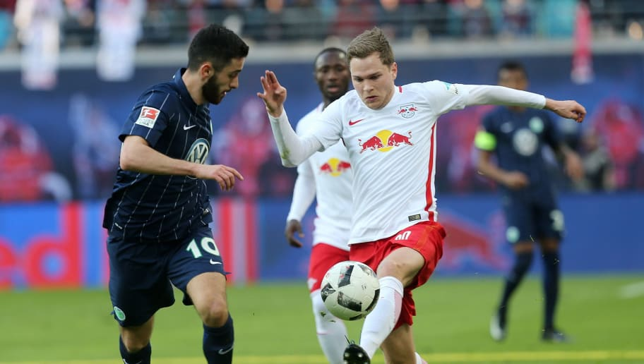 LEIPZIG, GERMANY - MARCH 11:  Benno Schmitz (R) of Leipzig battles for the ball with Yunus Malli (L) of Wolfsburg during the Bundesliga match between RB Leipzig and VfL Wolfsburg at Red Bull Arena on March 11, 2017 in Leipzig, Germany.  (Photo by Matthias Kern/Bongarts/Getty Images)