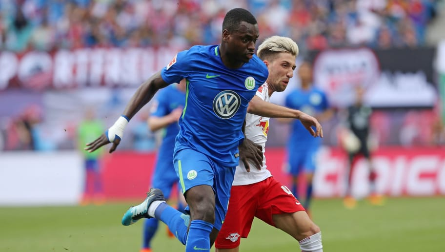 LEIPZIG, GERMANY - MAY 05:  Kevin Kampl (R) of Leipzig battles for the ball with Nany Landry Dimata of Wolfsburg during the Bundesliga match between RB Leipzig and VfL Wolfsburg at Red Bull Arena on May 5, 2018 in Leipzig, Germany.  (Photo by Matthias Kern/Bongarts/Getty Images)