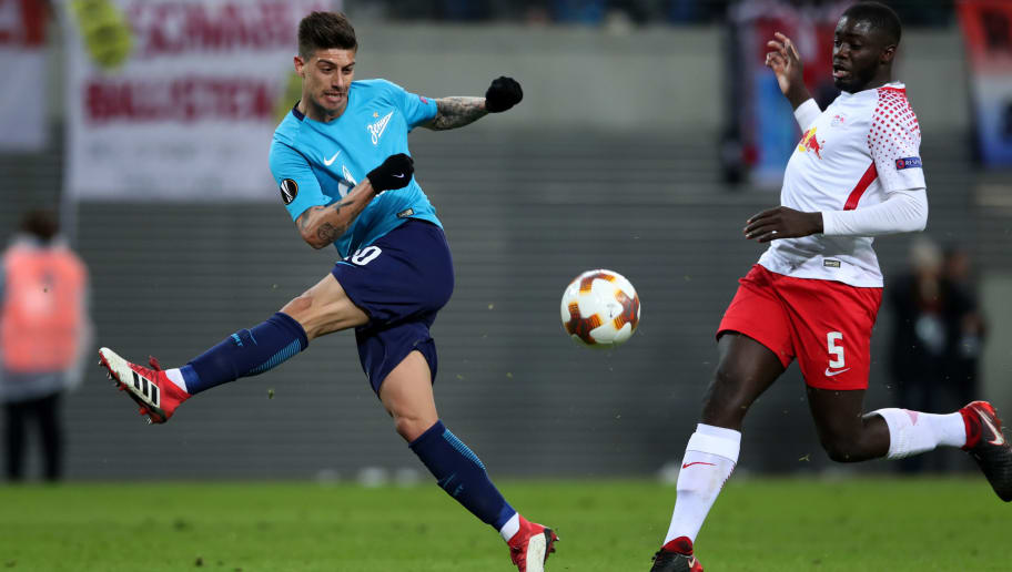 LEIPZIG, GERMANY - MARCH 08: Dayot Upamecano (R) of RB Leipzig vies with Emiliano Rigoni (L) of FC Zenit Saint Petersburg during the UEFA Europa League Round of 16 match between RB Leipzig and Zenit St Petersburg at the Red Bull Arena on March 8, 2018 in Leipzig, Germany. (Photo by Ronny Hartmann/Bongarts/Getty Images)