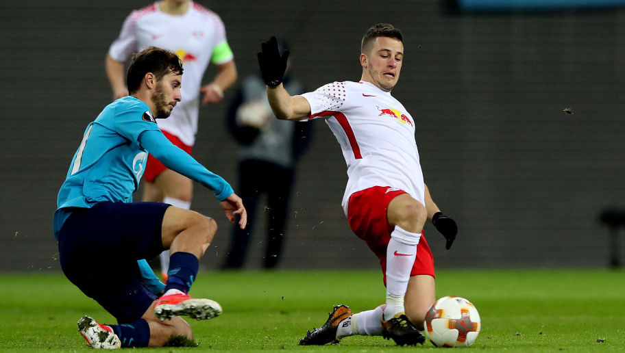 LEIPZIG, GERMANY - MARCH 08: Diego Demme (L) of RB Leipzig vies with Aleksandr Erokhin (R) of FC Zenit Saint Petersburg during the UEFA Europa League Round of 16 match between RB Leipzig and Zenit St Petersburg at the Red Bull Arena on March 8, 2018 in Leipzig, Germany. (Photo by Ronny Hartmann/Bongarts/Getty Images)