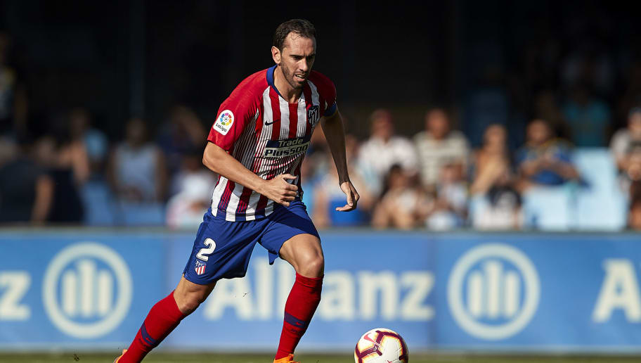 VIGO, SPAIN - SEPTEMBER 01:  Diego Godin of Atletico de Madrid in action during the La Liga match between RC Celta de Vigo and Club Atletico de Madrid at Abanca Balaidos Stadium on September 1, 2018 in Vigo, Spain  (Photo by Quality Sport Images/Getty Images)
