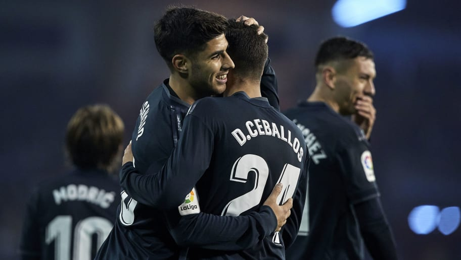 VIGO, SPAIN - NOVEMBER 11:  Daniel Ceballos of Real Madrid celebrates with Marco Asensio of Real Madrid after scoring his team's fourth goal during the La Liga match between RC Celta de Vigo and Real Madrid CF at Abanca Balaidos Stadium on November 11, 2018 in Vigo, Spain  (Photo by Quality Sport Images/Getty Images)