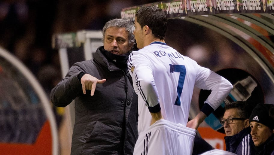 LA CORUNA, SPAIN - FEBRUARY 23:  Head coach Jose Mourinho (L) of Real Madrid CF gives instructions to Cristiano Ronaldo (2ndl) on the desk during the La Liga match between RC Deportivo La Coruna and Real Madrid CF at Riazor Stadium on February 23, 2013 in La Coruna, Spain.  (Photo by Gonzalo Arroyo Moreno/Getty Images)