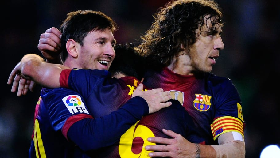 SEVILLE, SPAIN - DECEMBER 09:  Lionel Messi of FC Barcelona (R) celebrates with his teammates Xavi Hernandez (C) and Carles Puyol of FC Barcelona after scoring his team's second goal the La Liga match between Real Betis Balompie and FC Barcelona at Estadio Benito Villamarin on December 9, 2012 in Seville, Spain. With this goal Lionel Messi beats the 1972 scoring record set by Gerd Muller of 85 goals in one year.  (Photo by David Ramos/Getty Images)