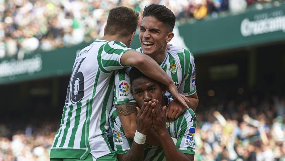 SEVILLE, SPAIN - DECEMBER 2: Junior Firpo of Real Betis Balompie celebrates after scoring with Marc Bartra of Real Betis Balompie and Loren Moron of Real Betis Balompie during the La Liga match between Real Betis Balompie and Real Sociedad at Estadio Benito Villamari on DECEMBER 2, 2018 in Seville, Spain. (Photo by Aitor Alcalde Colomer/Getty Images)