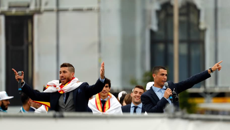 MADRID, SPAIN - MAY 27: Sergio Ramos of Real Madrid and Cristiano Ronaldo of Real Madrid gesture after winning yesterday's Uefa Champions League Final match at Cibeles Square on May 27, 2018 in Madrid, Spain. (Photo by TF-Images/Getty Images)