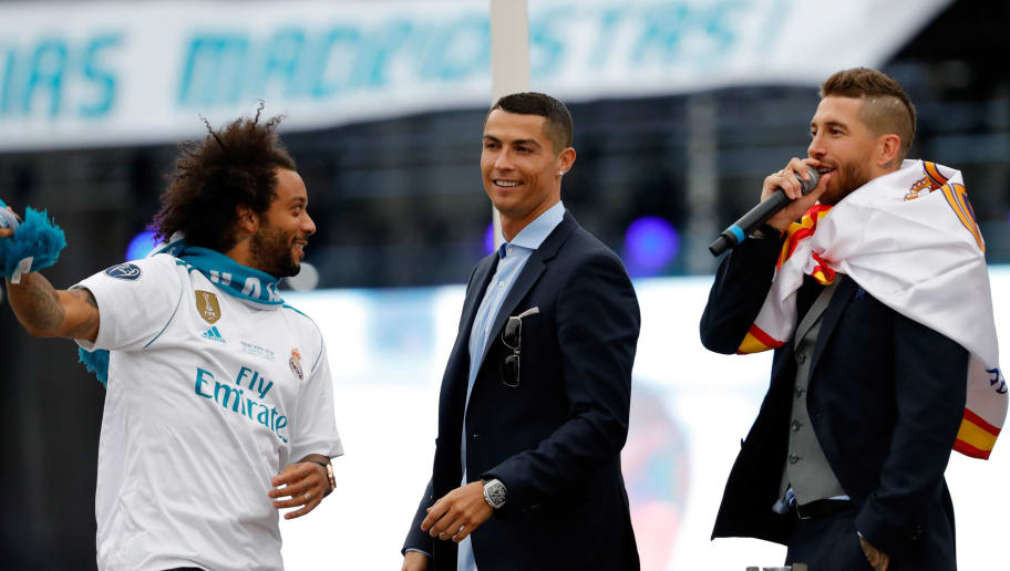 MADRID, SPAIN - MAY 27: Sergio Ramos of Real Madrid and Cristiano Ronaldo of Real Madrid laugh after winning yesterday's Uefa Champions League Final match at Cibeles Square on May 27, 2018 in Madrid, Spain. (Photo by TF-Images/Getty Images)