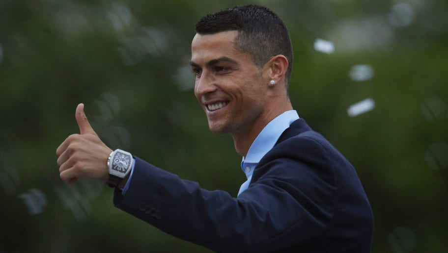 MADRID, SPAIN - MAY 27: Cristiano Ronaldo of Real Madrid CF celebrates their Champions League victory at Cibeles Square a day after winning their 13th European Cup and UEFA Champions League Final on May 27, 2018 in Madrid, Spain. (Photo by Gonzalo Arroyo Moreno/Getty Images)
