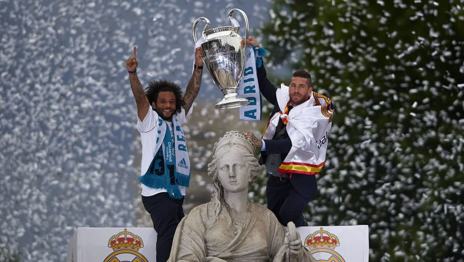 MADRID, SPAIN - MAY 27:  Sergio Ramos (R) and Marcelo of Real Madrid hold the UEFA Champions League tropy during Real Madrid team celebration at Cibeles Square after winning their 13th European Cup on May 27, 2018 in Madrid, Spain.  (Photo by Quality Sport Images/Getty Images)