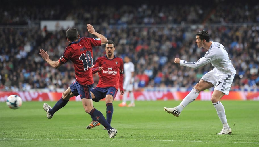 MADRID, SPAIN - APRIL 26:  Cristiano Ronaldo of Real Madrid CF scores Real's second goal during the La Liga match between Real Madrid CF and CA Osasuna at the Santiago Bernabeu stadium on April 26, 2014 in Madrid, Spain.  (Photo by Denis Doyle/Getty Images)