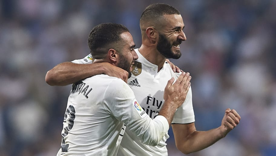 MADRID, SPAIN - SEPTEMBER 01:  Karim Benzema (R) of Real Madrid celebrates after scoring his team's third goal with Dani Carvajal during the La Liga match between Real Madrid CF and CD Leganes at Estadio Santiago Bernabeu on September 1, 2018 in Madrid, Spain.  (Photo by Quality Sport Images/Getty Images)