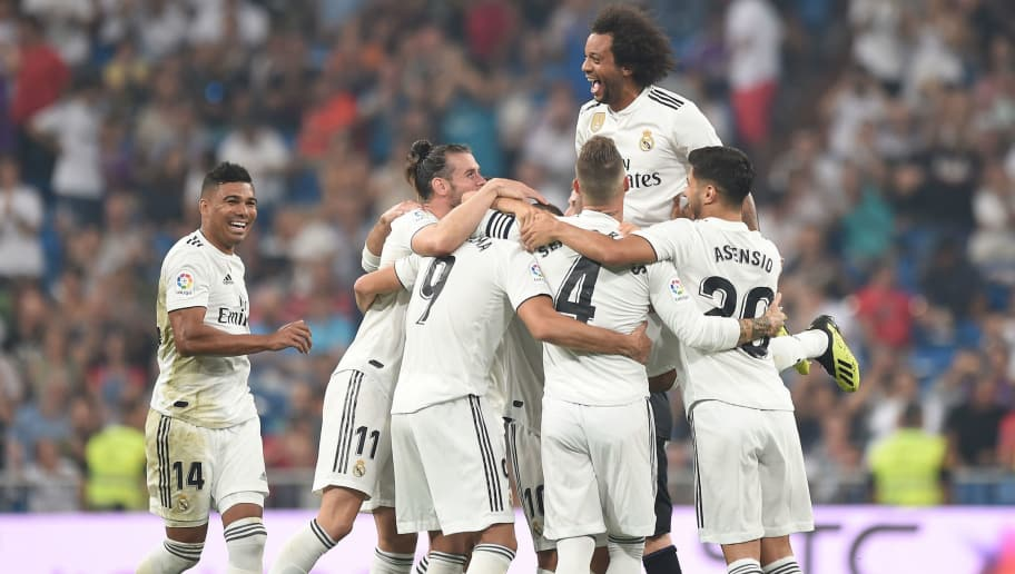 MADRID, SPAIN - SEPTEMBER 01:  Karim Benzema (#9) of Real Madrid celebrates with teammates after scoring his teams second goal during the La Liga match between Real Madrid CF and CD Leganes at Estadio Santiago Bernabeu on September 1, 2018 in Madrid, Spain. (Photo by Denis Doyle/Getty Images)