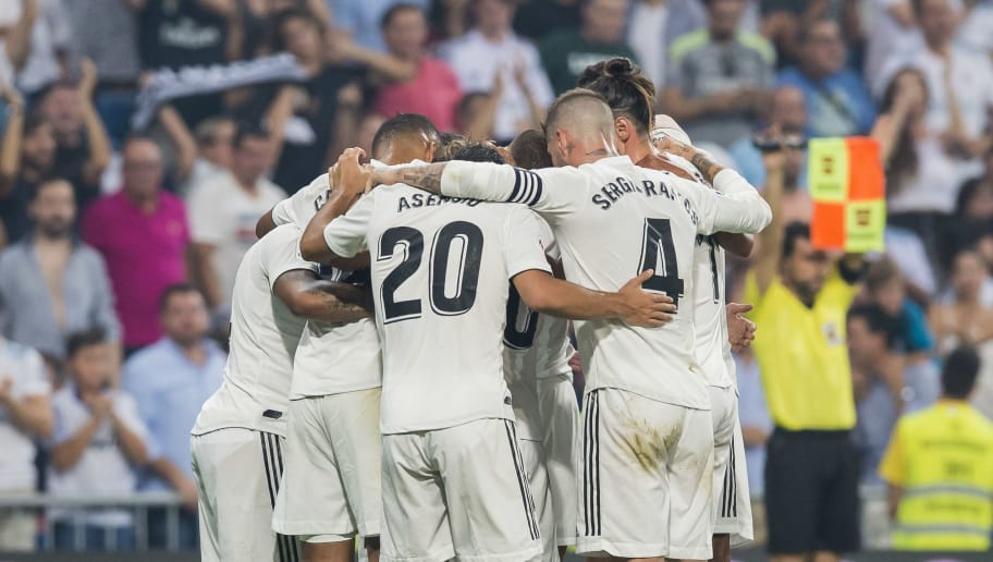 MADRID, SPAIN - SEPTEMBER 01: Players of Real Madrid celebrate for teammate Karim Benzema's scoring his second goal as soccer fans of the team applaud at the stand during the La Liga match between Real Madrid CF and CD Leganes at Estadio Santiago Bernabeu on September 1, 2018 in Madrid, Spain. (Photo by Power Sport Images/Getty Images)